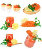 Caviar red in a glass jar with lemon and parsley — Stock Photo