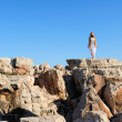 Stock Photo: Girl standing on a cliff