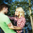 Portrait of love couple embracing outdoor in park — Stock fotografie