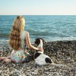 Foto de Stock  : Beautiful woman with a dog on the beach