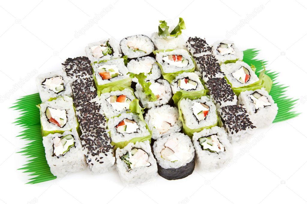 Sushi set - Different types of maki sushi and rolls. Served on green Leaves  — Stock Photo #7451584