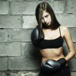 Portrait of young woman boxing — Stock Photo