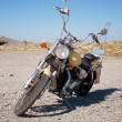 Stock Photo: Old motorcycle is in vacant lot autumn day