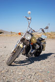 Old motorcycle is in a vacant lot autumn day — Stock Photo
