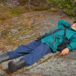 Elderly tourist resting on the rock — Stock Photo