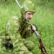 Stock Photo: Hunter with old rifle is considering trail