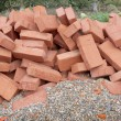 Red clay bricks lying on the gravel — Stock Photo #7503999