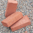 Three red clay bricks — Stock Photo
