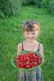 The little girl with strawberries — Stock Photo