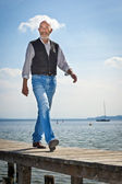 Old man walking — Stock Photo