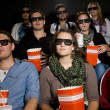 Spectators at cinema — Stock Photo