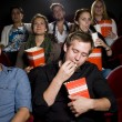 Man at the cinema with popcorn — Stock Photo