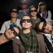 Stock Photo: Cinema spectators with 3d glasses