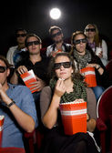 Eating popcorn at the cinema — Stock Photo