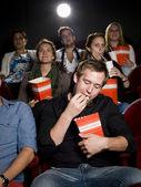 Man at the cinema with popcorn — Stock Photo