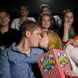 Young couple at the cinema — Stock Photo