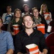Stock Photo: Man at the cinema with popcorn
