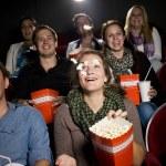 Eating popcorn at the cinema — Stock Photo