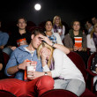Young couple at cinema — Stock Photo