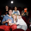 Stock Photo: Young couple at cinema