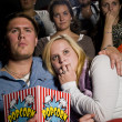Young couple at the cinema — Stock Photo #6995180