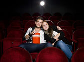 Young couple at the cinema — ストック写真