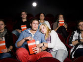 Scared couple at cinema — Stock Photo