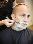 Shaving at the hair salon — Stock Photo
