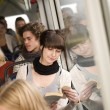Reading at the bus — Stock Photo