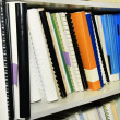 Library shelf full of references - Stock Photo