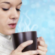 Young woman with hot beverage — Stock Photo