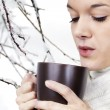 Young woman with hot beverage — Foto de Stock