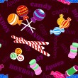 Seamless pattern of candy and bonbon over dark background - Stock Vector