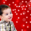 Stock Photo: Cute little boy on red background with lights