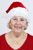 Vertical of grandma with Christmas hat — Stock Photo