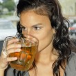 Young woman drinking beer — Stock Photo
