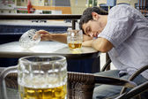 Young man passed out drunk — Stock Photo