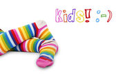 Colorful kid's feet — Stock Photo
