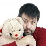 Guy hugging teddy bear — Stock Photo