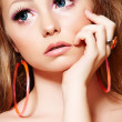 Fashion model with doll make-up, long eyelashes, big blue eyes - Stock Photo