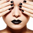 Stock Photo: High fashion style, manicure, cosmetics and make-up. Dark lips make-up