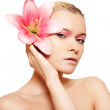 Beautiful portrait of luxury woman with fashion make-up and big pink flower — Stock Photo