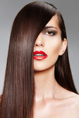 Woman model with red lips. Fashion hairstyle with smooth long female hair — Stock Photo