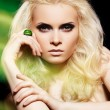 Alluring blond woman model with big ring in magic green mist. Glamour image — Stock Photo