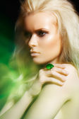 Beautiful blond woman model with big ring in magic mist. Glamour style — Stock Photo