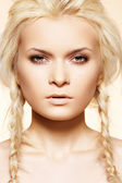 Beautiful blond woman with fashion hairstyle with pigtail — Stock Photo