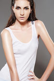 Beautiful fashion slim wet woman model in white blank t-shirt — Stock Photo