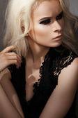 Luxury & chic beauty. Sexy beautiful blond woman model in black dress — Stock Photo