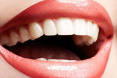 Close-up happy female smile with healthy white teeth, bright gloss lips — Stock Photo