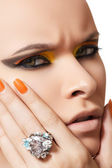 Close-up portrait of beautiful model face with neon yellow fashion make-up — Stock Photo